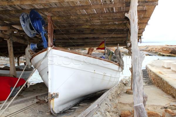 Formentera boat stranded on wooden rails Stock photo © lunamarina