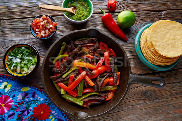 Beef fajitas in a pan with sauces Mexican food Stock photo © lunamarina