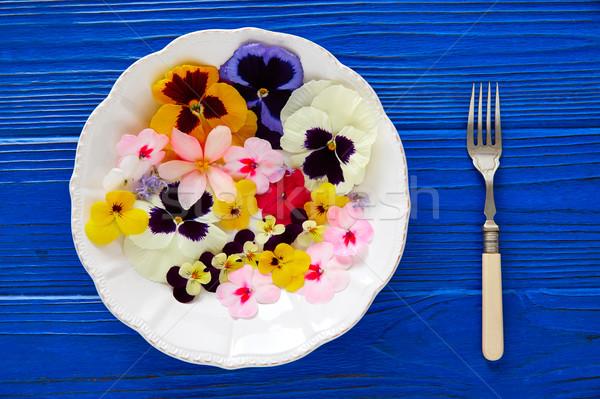 Edible flowers salad in a plate Stock photo © lunamarina