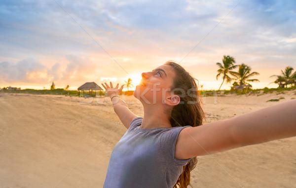 Open arms girl at sunset caribbean beach Stock photo © lunamarina