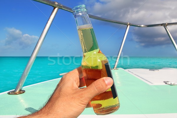 beer on hand Caribbean in boat bow turquoise sea Stock photo © lunamarina