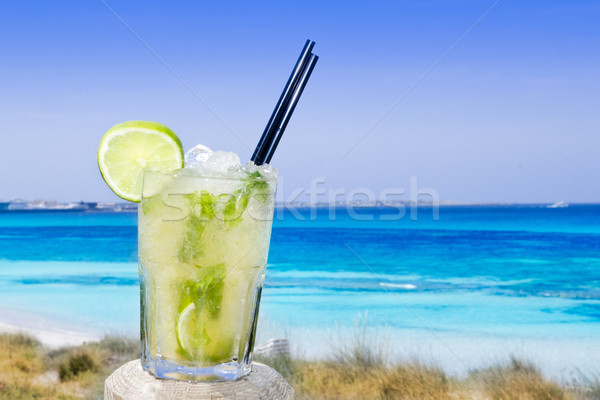 Cocktail mojito ice lemon straws in tropical beach Stock photo © lunamarina