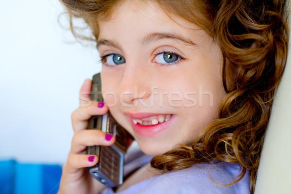 Child girl indented talking mobile telephone Stock photo © lunamarina
