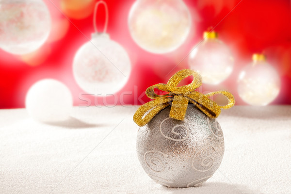 Christmas silver bauble with golden loop on snow Stock photo © lunamarina