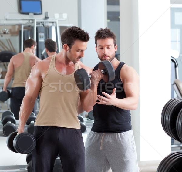 Stock photo: gym personal trainer man with weight training