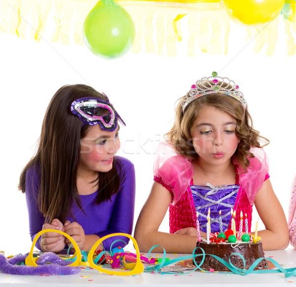 Stock photo: children happy girls blowing birthday party cake