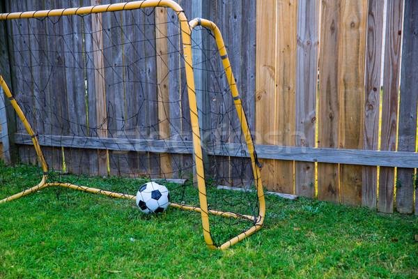 Backyard chldren soccer at the wood fence with wall Stock photo © lunamarina