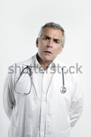 doctor senior expertise gray hair on white Stock photo © lunamarina
