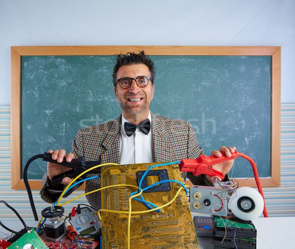 Nerd electronics technician retro silly expression Stock photo © lunamarina