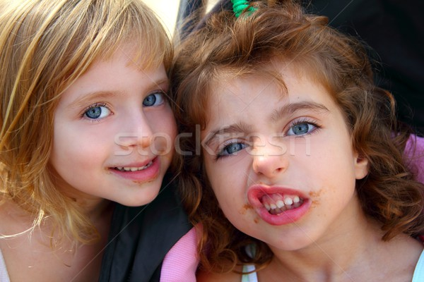 funny two little sister girls funny face gesture Stock photo © lunamarina