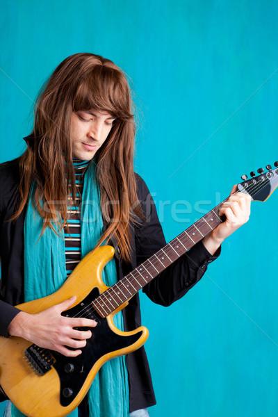 Rock années soixante-dix guitare électrique joueur homme cheveux longs Photo stock © lunamarina