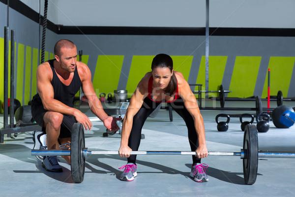 Tornaterem személyi edző férfi súlyemelés bár nő Stock fotó © lunamarina