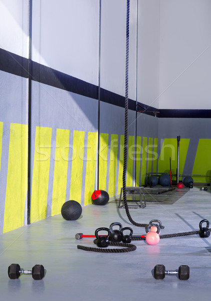 Stock photo: Crossfit Kettlebells ropes and hammer gym wall balls