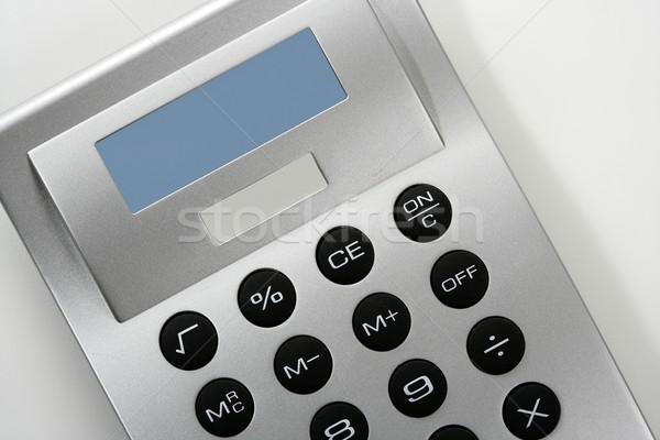 Calculator in gray silver color with solar cell Stock photo © lunamarina
