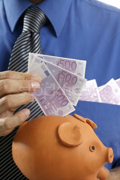 businessman insert euro notes in piggy bank Stock photo © lunamarina