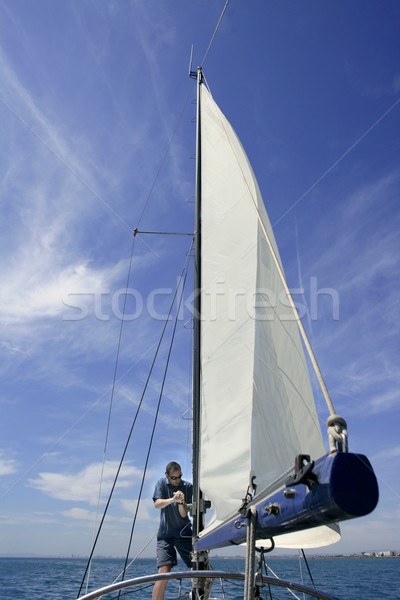 Sailor in sailboat rigging the sails Stock photo © lunamarina