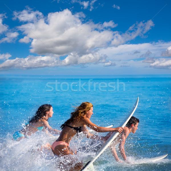 Erkek kızlar genç sörfçü sörf Stok fotoğraf © lunamarina