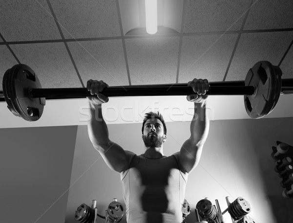 Barbell man workout fitness at weightlifting gym Stock photo © lunamarina