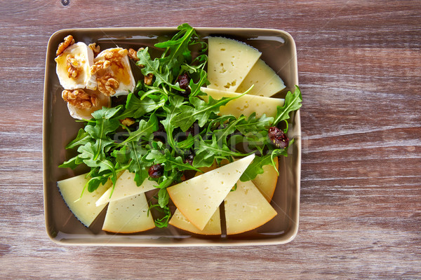 Arugula salad with goat cheese honey and nuts Stock photo © lunamarina