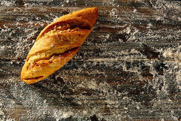 Bread loaf in a rustic wood and wheat flour Stock photo © lunamarina