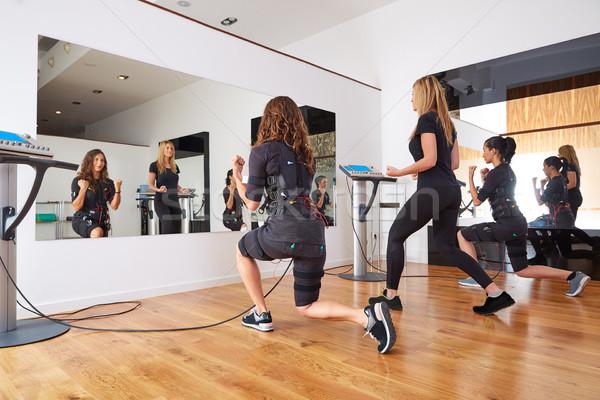 Stock photo: EMS electro stimulation women exercises