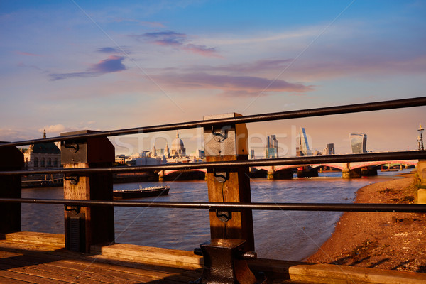 London skyline at sunset from Thames Stock photo © lunamarina