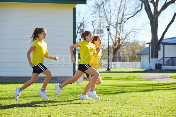 Teen girls group running workout at park Stock photo © lunamarina