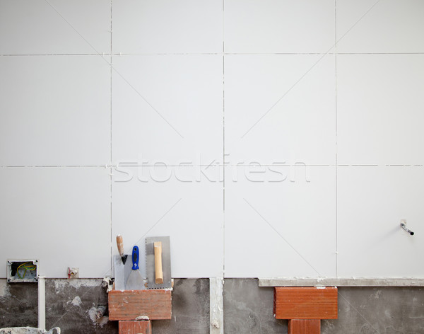 tiles white wall contruction with trowels tools Stock photo © lunamarina