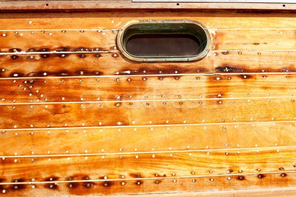 boat oval porthole in wooden hull Stock photo © lunamarina