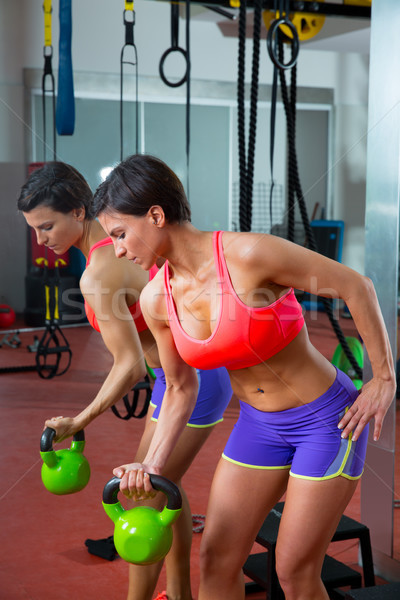 Crossfit fitness lifting Kettlebell woman at mirror workout Stock photo © lunamarina