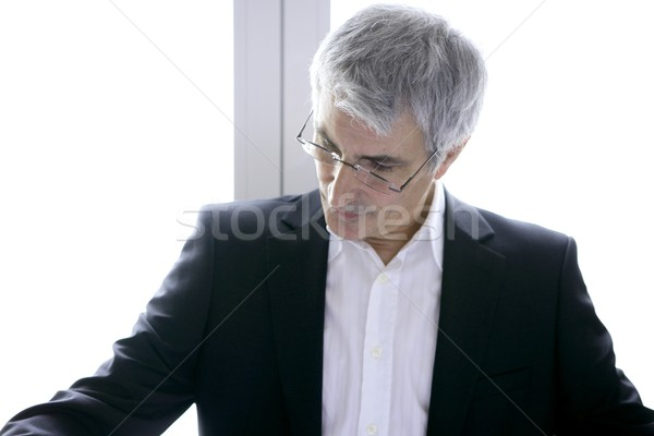 businessman senior gray hair looking down Stock photo © lunamarina