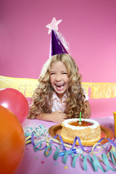 happy little blond girl in a birthday party laughing with candle Stock photo © lunamarina