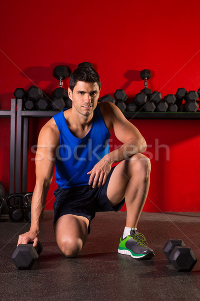 Stock photo: Hex dumbbells man workout in red gym