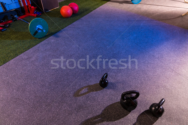 Kettlebells and Barbells in a gym Stock photo © lunamarina