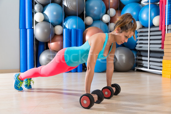 Girl at gym push-up pushup exercise dumbbells Stock photo © lunamarina