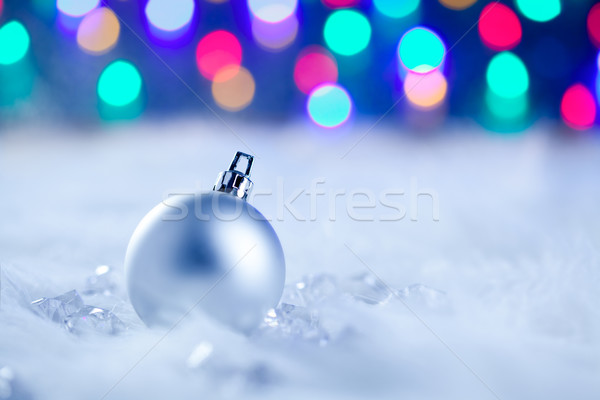 Stock photo: Christmas silver bauble in blurred lights