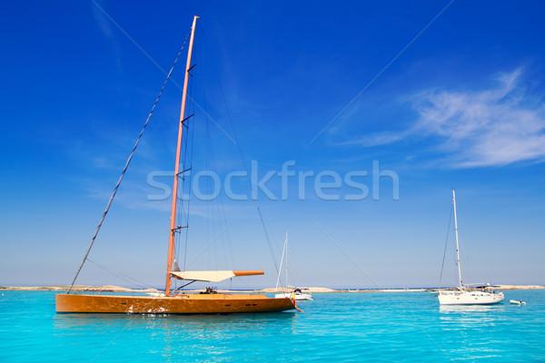 sailboat in turquoise beach of Formentera Stock photo © lunamarina