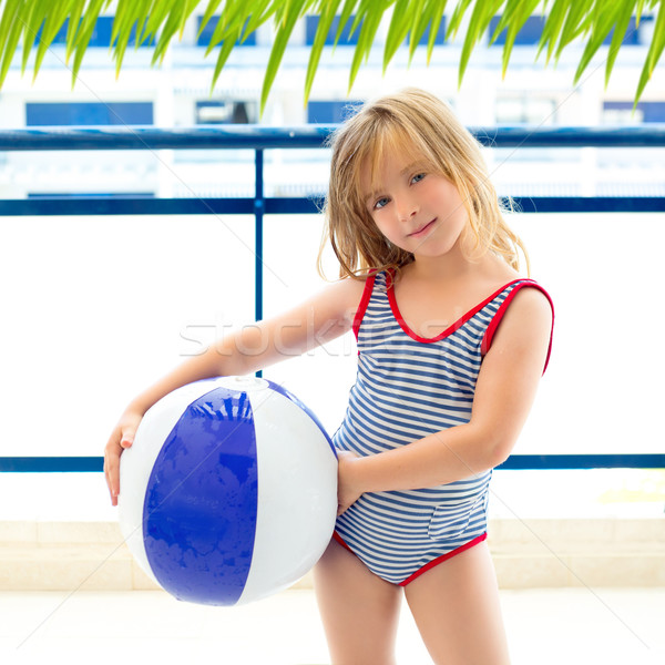 Blond kid girl with swimsuit with summer blue ball Stock photo © lunamarina