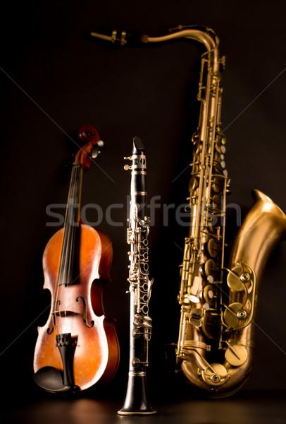 Music Sax tenor saxophone violin and clarinet in black Stock photo © lunamarina