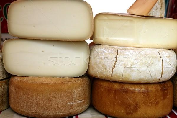 Aged french cheese wheels stacked Stock photo © lunamarina