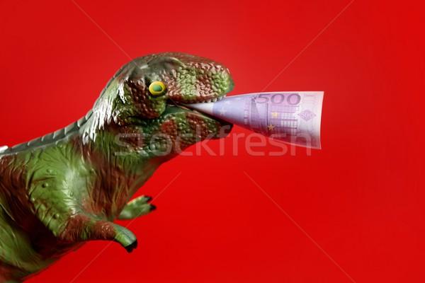 игрушку динозавр евро сведению деньги бумаги Сток-фото © lunamarina
