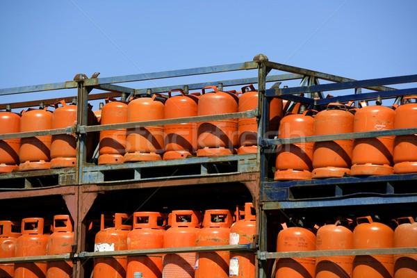 Botellas, bombonas de gas butano color Naranja. Orange Gas Racks Stock photo © lunamarina