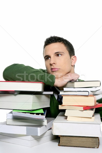Young unhappy student with stacked books Stock photo © lunamarina