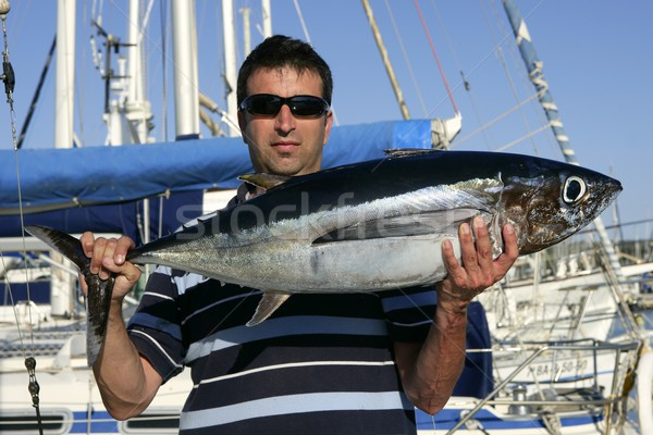 Big game fisherman with saltwater tuna Stock photo © lunamarina