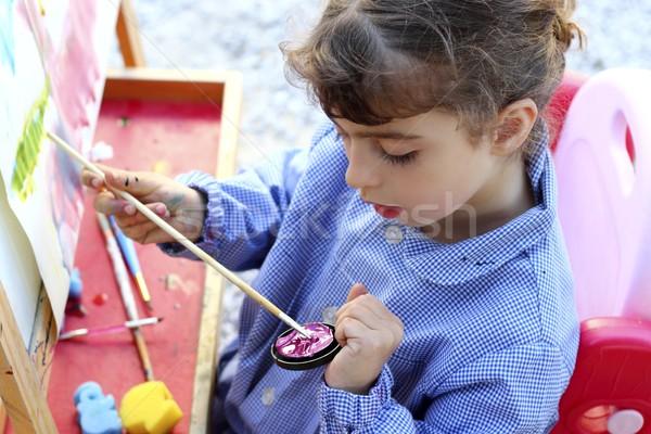 Stock photo: artist school little girl painting watercolors portrait