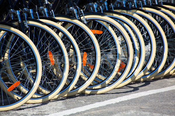 Stock photo: Bicycles front wheel tyres in a row