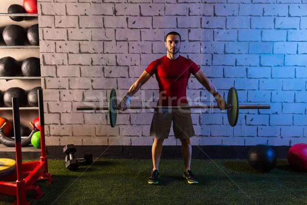 Barbell gewichtheffen man training oefening gymnasium Stockfoto © lunamarina