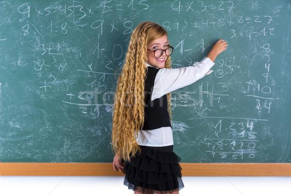 Stréber szőke lány zöld tábla iskolás lány Stock fotó © lunamarina