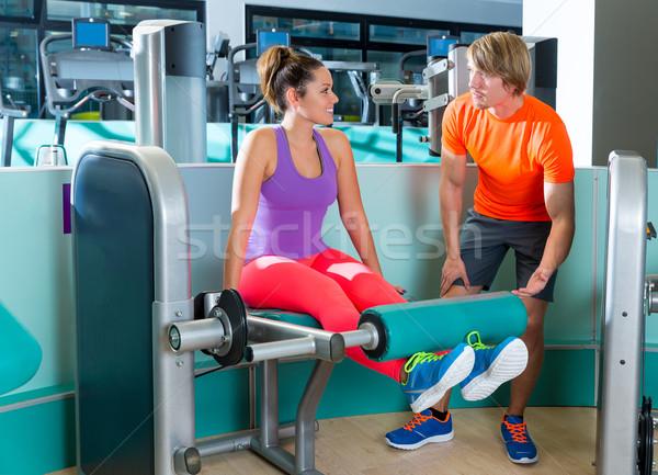 Gym leg extension workout woman personal trainer Stock photo © lunamarina