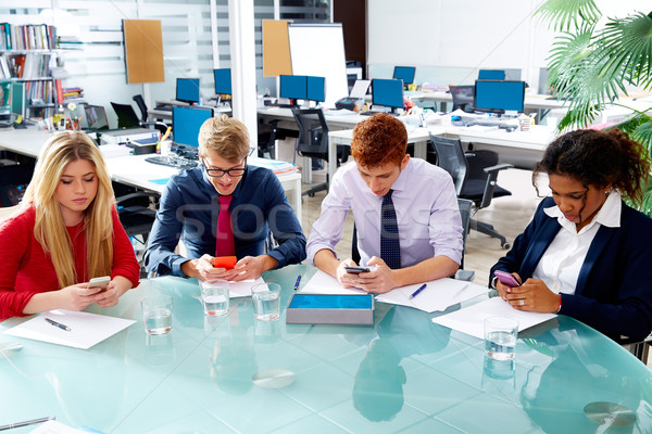 Business people team playing smartphones Stock photo © lunamarina